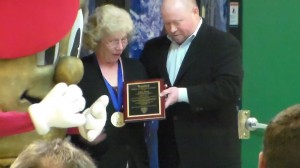 Spike's owner Ted Westervelt and Spike present Edna with teh Everyday Greatness Award